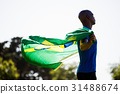 Athlete posing with brazilian flag after victory 31488674