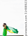 Athlete posing with brazilian flag after victory 31488923
