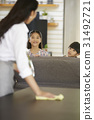 Mother and two her daughters are chatting while cleaning. 31492721