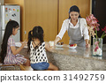Woman is bringing a glass of milk to her daughters. 31492759