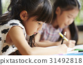Two cute girls are drawing with colorful pencils at home 31492818