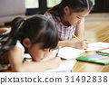 Portrait of little children learning with pencil and notebook on floor 31492838
