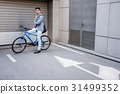 Confident smiling male person sitting at bike 31499352