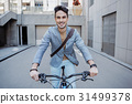 Hilarious smiling male person driving bicycle 31499378