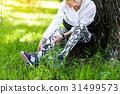 Serious old woman having break of training 31499573