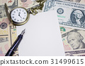pen, paper and classic pocket watch on dollar ban 31499615
