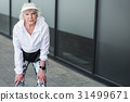 Thoughtful elderly woman having break time while 31499671