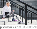 Joyful aged lady relaxing after climbing upstairs 31500170