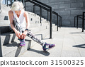 Concentrated senior lady going to begin exercise 31500325