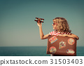 Child with vintage suitcase on summer vacation 31503403