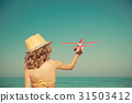 Happy child playing with toy airplane 31503412