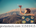 Happy child playing with toy airplane 31503415