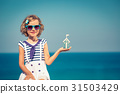 Child with toy house on summer vacation 31503429