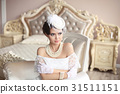 Retro woman portrait. Elegant brunette lady in hat 31511151