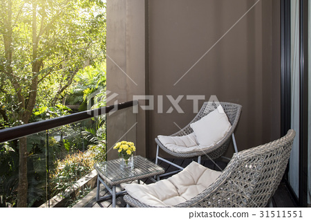 Wicker chair with view at terrace 31511551