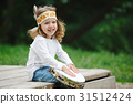 little funny girl playing native american 31512424