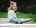 little funny girl playing native american 31512426