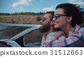 Young couple speeding along in a motorboat 31512663