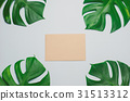 Brown card with green leaves on blue background 31513312