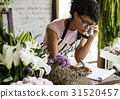 Business of flower shop with woman owner 31520457