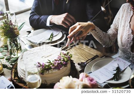 Bride and Groom Cutting Cake on Wedding Reception 31520730