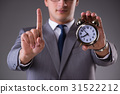 Businessman in time management concept 31522212