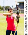 Female athlete practicing archery 31522792