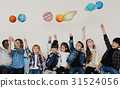 Group of Kids Holding Papercraft Galaxy Symbol on White Blackground 31524056