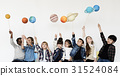 Group of Kids Holding Papercraft Galaxy Symbol on White Blackground 31524084
