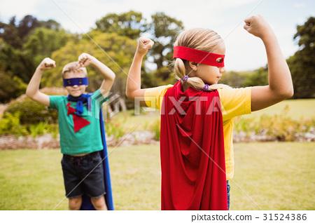 Children wearing superhero costume posing for camera 31524386