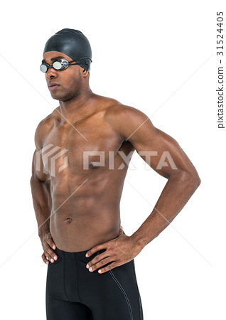 Swimmer standing with hand on hip 31524405
