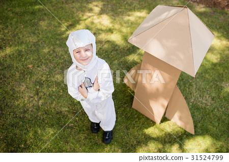 Boy is dressing up as an astronaut 31524799