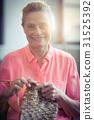 Portrait senior woman knitting wool 31525392