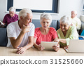 Seniors using technology 31525660