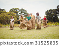 Children having a sack race 31525835