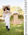 Adorable boy pretending to be astronaut 31526567