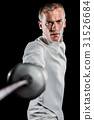 Man wearing fencing suit practicing with sword 31526684