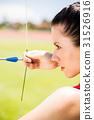 Female athlete practicing archery 31526916