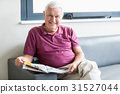 Senior man reading the newspaper 31527044