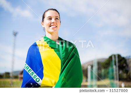 Female athlete wrapped in Brazilian flag 31527800
