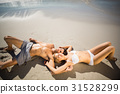 Couple lying on beach 31528299