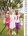 Three girls wearing costume posing for the camera 31528893