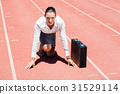 Portrait of happy businesswoman with briefcase in ready to run position 31529114