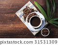 coffee cup and beans on the wood background. 31531309