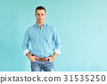 Businessman standing in office with crossed arms 31535250