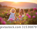 Beautiful child girl with young happy mother are 31536879
