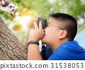 Asian kid take a photo animal 31538053