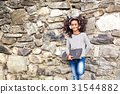 African american girl with skateboard and 31544882