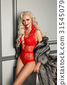 Sexy alluring blond woman in red lingerie posing 31545079