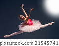Beautiful female ballet dancer on a dark 31545741